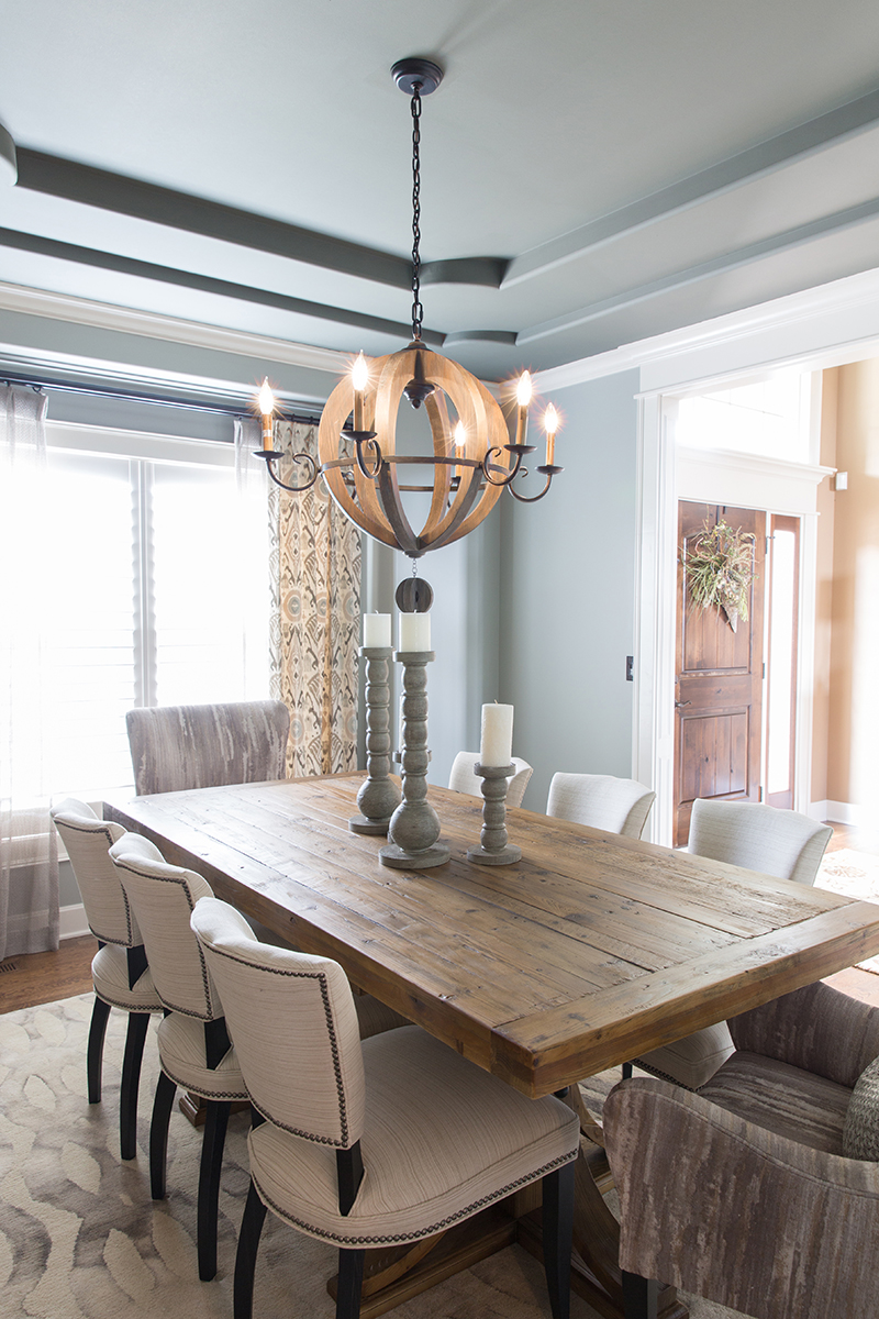 Area Rug With Metal Details Such As The New Sconces Side Chair Nailheadsand Ceiling Fixture Rounds Out Theme Of Space Changing A Once Dark